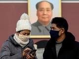 Người dân tại Bắc Kinh, Trung Quốc đeo khẩu trang đề phòng viêm phổi Vũ Hán. Ảnh: AFP.