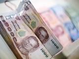 Đồng baht Thái Lan từ chỗ đồng tiền mạnh nhất trở thành đồng tiền yếu nhất châu Á trong năm nay (Ảnh: AsiaOne)