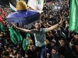 Người dân ăn mừng lệnh ngừng bắn tại Khan Yunis, phía Nam Dải Gaza (Ảnh: AFP)