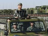 Chủ tịch Trung Quốc Tập Cận Bình yêu cầu tập trung hơn vào phát triển quân đội (Ảnh: AP)