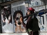 Những tấm poster có hình phụ nữ bị bôi xóa phần mặt (Ảnh: AFP)
