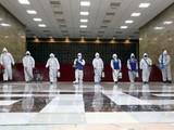 Nhân viên y tế phun thuốc khử trùng phòng dịch COVID-19. Ảnh: AFP