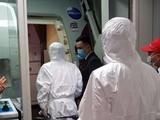 Xử lý chuyến bay đầu tiên có 2 hành khách trên du thuyền Westerdam quá cảnh sân bay Tân Sơn Nhất. Ảnh: CDC