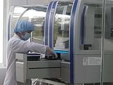 Hệ thống Realtime PCR tự động xét nghiệm Covid-19 tỉnh Quảng Nam mua với giá 7,2 tỷ đồng. Ảnh: SGGP