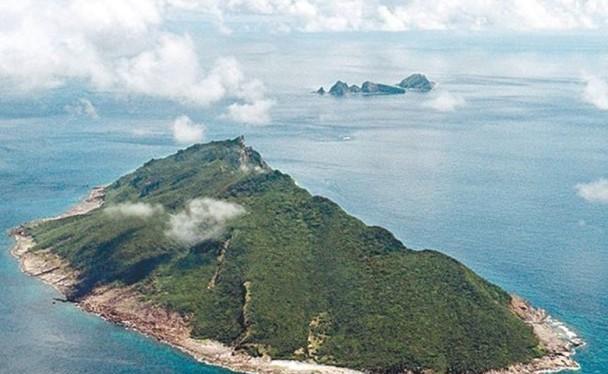 Kyodo News cho rằng hai bên Nhật, TRung cùng ám chỉ sử dụng vũ lực ẩn chứa nguy cơ leo thang thành tình huống nguy hiểm khó lường ở Senkaku (Ảnh: zaobao).
