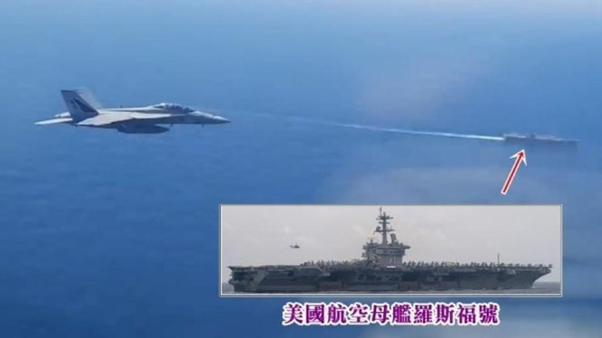 Hình ảnh trích video do máy bay Nga quay cho thấy chiếc F/A18 áp sát máy bay Nga, phía dưới là tàu sân bay Mỹ (Ảnh: Đông Phương).