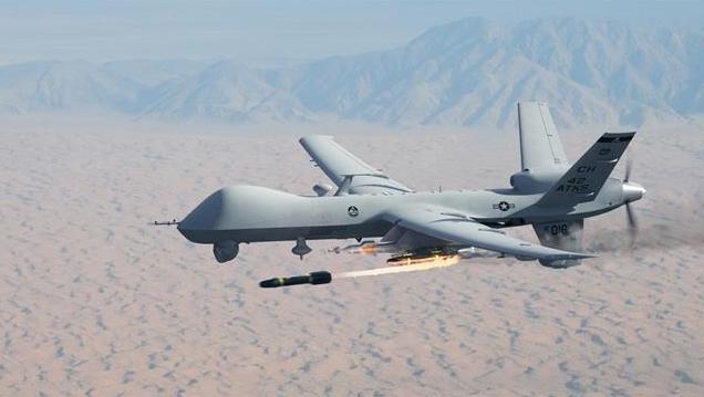 Máy bay không người lái Mỹ phóng tên lửa diệt mục tiêu (Ảnh: Creaders).
