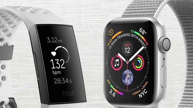 Fitbit Charge 3 và Apple Watch Series 4. Ảnh: Gadgetsandwearables