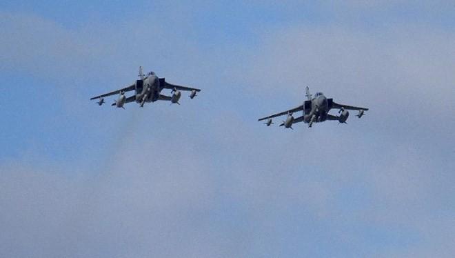 Máy bay liên quân tiến hành không kích ở Syria. (Nguồn: AFP)