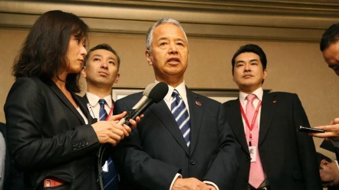 Bộ trưởng Kinh tế Nhật Akira Amari thông báo kết quả đàm phán Ảnh: AFP