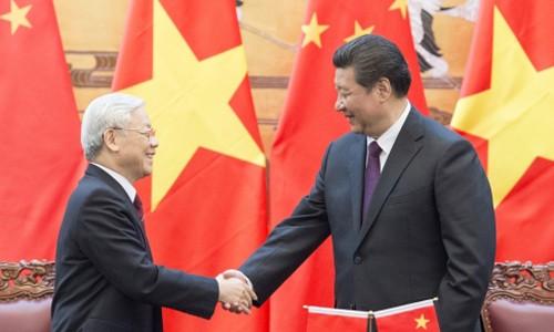 Chủ tịch Trung Quốc Tập Cận Bình (phải) đón tiếp Tổng bí thư đảng Cộng sản Việt Nam Nguyễn Phú Trọng tại Bắc Kinh ngày 7/4. Ảnh: Xinhua