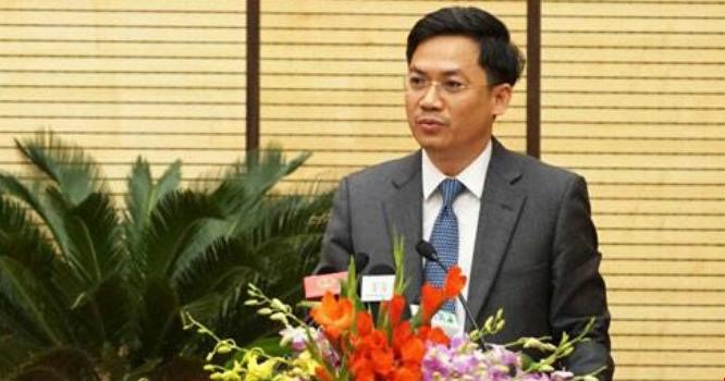 Ông Hà Minh Hải, Cục trưởng Cục Thuế Hà Nội trả lời chất vấn về nợ thuế. Ảnh: Minh Huệ