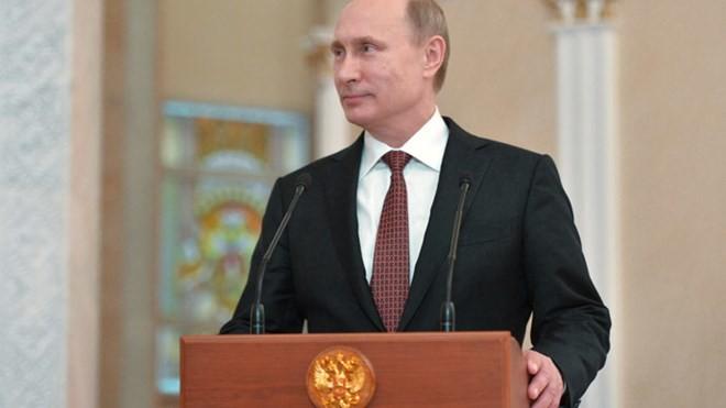 Tổng thống Nga Vladimir Putin trả lời phỏng vấn báo giới sau cuộc hồi đàm tại Minsk