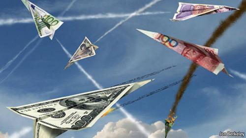Một cuộc chiến tiền tệ giữa các nước có thể dẫn đến cuộc chiến thương mại. Ảnh: AFP/TTXVN