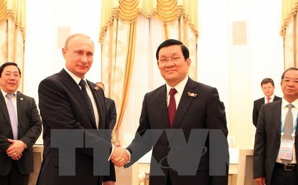Tổng thống Liên bang Nga Vladimir Putin và Chủ tịch nước Trương Tấn Sang. (Ảnh: Nguyễn Khang/TTXVN)
