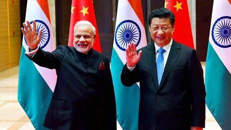Thủ tướng Ấn Độ Narendra Modi (trái) và Chủ tịch Trung Quốc Tập Cận Bình (phải) trong một cuộc hội đàm tại thành phố Tây An. (Ảnh: PTI)