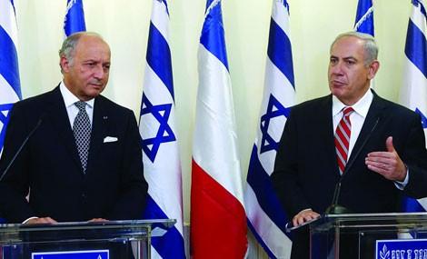 Ngoại trưởng Pháp Laurent Fabius và Thủ tướng Israel Benjamin Netanyahu trong chuyến thăm ngày 21/6.