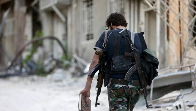 Một chiến binh thuộc thành phần chống chính phủ tại Syria (Nguồn: AFP)