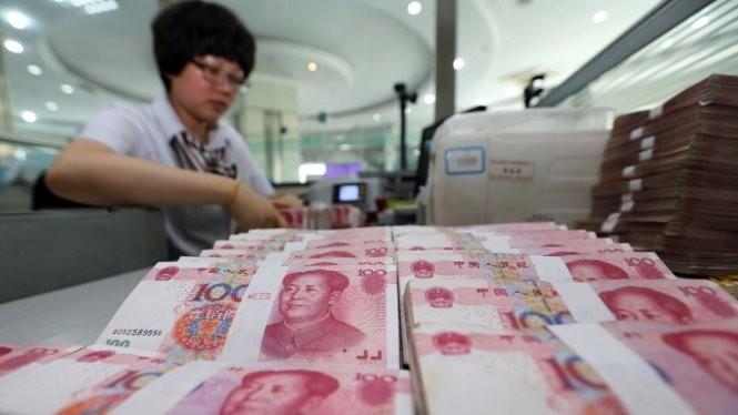 Đồng NDT giảm giá có thể dẫn tới chiến tranh tiền tệ Ảnh: AFP
