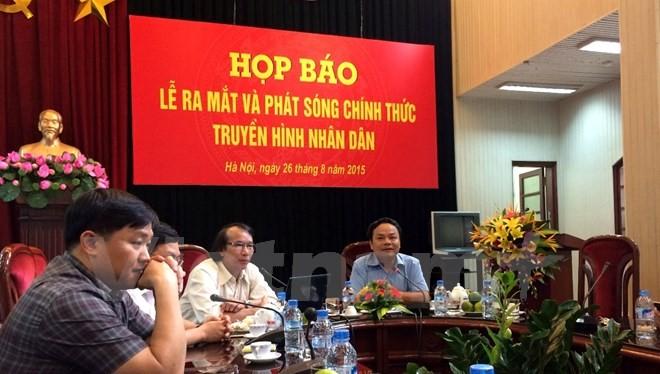 Lãnh đạo Báo Nhân Dân giới thiệu về kênh Truyền hình Nhân Dân với báo giới. (Ảnh: PV/Vietnam+)