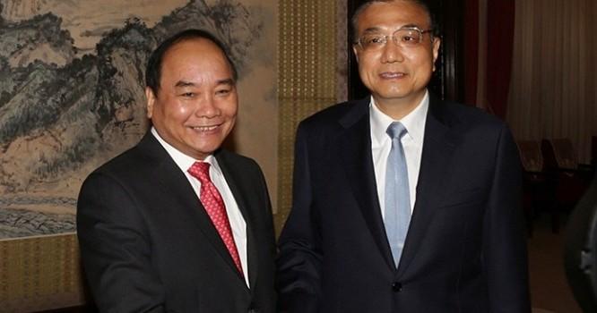 Phó Thủ tướng Nguyễn Xuân Phúc và Thủ tướng Trung Quốc Lý Khắc Cường