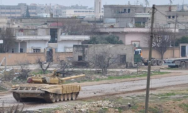 Xe tăng quân đội Syria tiến vào thành phố