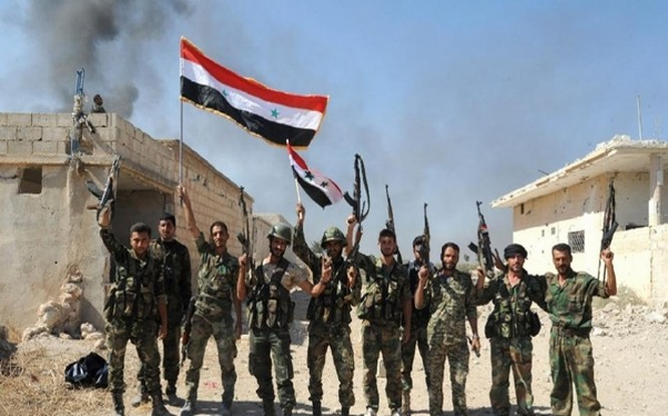 Quân đội của ông Assad ăn mừng sau khi giành chiến thắng trước lực lượng nổi dậy hôm 11/10.
