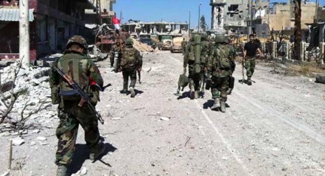 Các binh sĩ Syria chiến đấu ở Aleppo