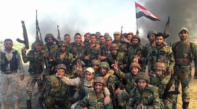 Binh sĩ quân đội Syria mừng chiến thắng quận Al-Ramouseh