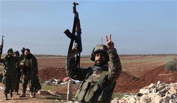 Binh sĩ quân đội Syria vui mừng trong 1 kết quả tấn công lực lượng Hồi giáo cực đoan