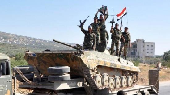 Binh sĩ quân đội Syria hành quân về vùng chiến sự tỉnh Hama