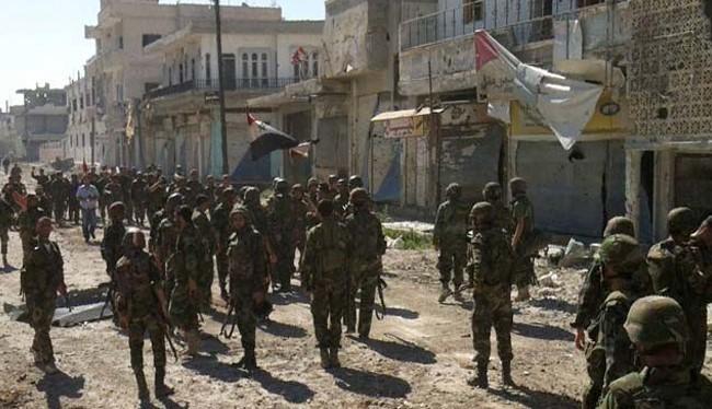 Binh sĩ Syria sau một trận chiến ác liệt trên đường phố Aleppo