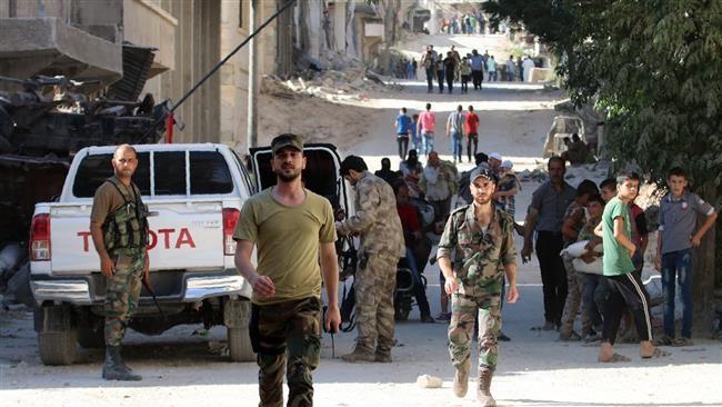 Những người dân Aleppo thoát khỏi sự kiểm soát của lực lượng Hồi giáo cực đoan ở Aleppo