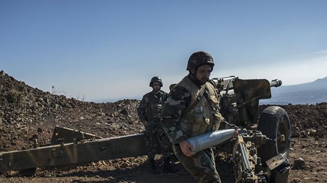 Một khẩu đội pháo binh hạng nặng của quân đội Syria ở Homs