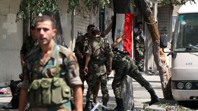 Binh sĩ quân đội Syria trên đường phố Daraa