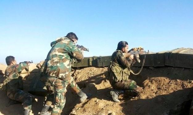 Binh sĩ quân đội Syria phòng thủ trong thành phố Deir Ezzor