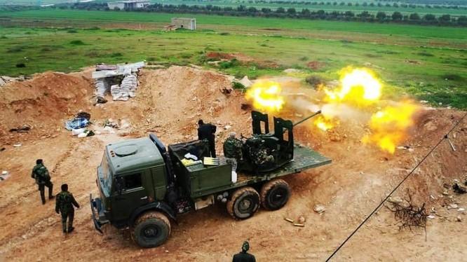 Quân đội Syria pháo kích đánh trả cuộc tấn công của lực lượng khủng bố ở Hama - ảnh Masdar News
