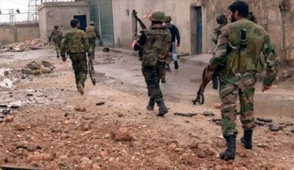 Binh sĩ quân đội Syria trên chiến trường phía đông Hama - ảnh minh họa Masdar News