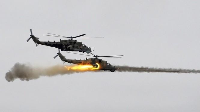 Trực thăng chiến đấu Nga trên chiến trường Syria - ảnh minh họa Masdar News