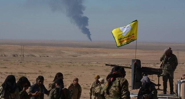 Binh sĩ lực lượng SDF trước một khu công nghiệp ở ngoại ô Deir Ezzor - ảnh minh họa South Front