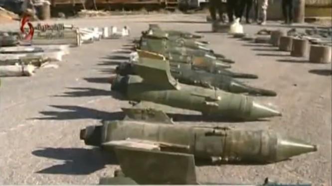 Vũ khí phi pháp bị an ninh quân đội Syria thu giữ - ảnh video truyền thông Syria
