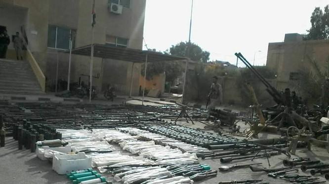 Kho vũ khí khổng lồ của IS ở Deir Ezzor vừa bị phát hiện - ảnh minh họa video SANA