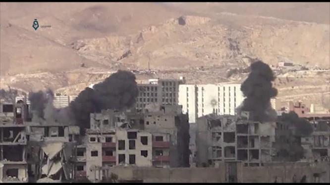 Không quân Syria tập kích hỏa lực dữ dội khu vực Đông Ghouta - ảnh minh họa video Masdar News