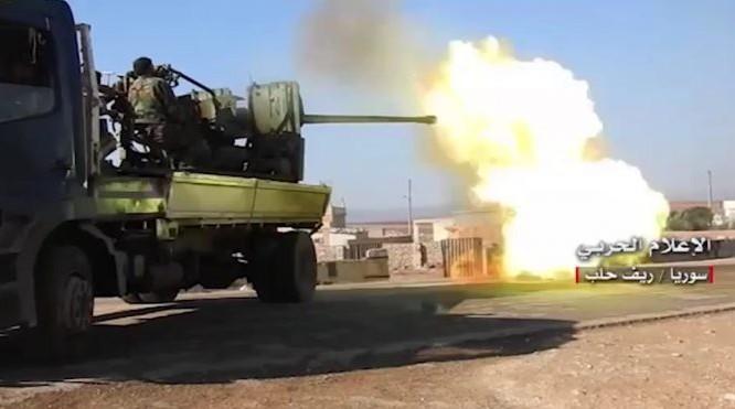 Pháo phòng không quân đội Syria xối đạn vào phiến quân ở Aleppo - video truyền thông Hezbollah