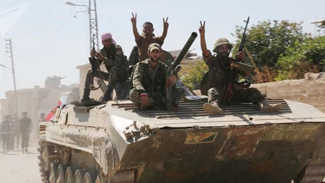 Binh sĩ quân đội Syria tiến công trên chiến trường Abu Al-Duhur. Ảnh minh họa Masdar News