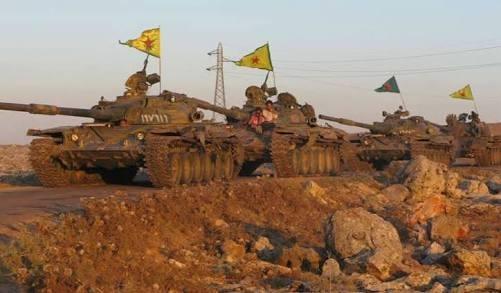 Đoàn xe tăng của lực lượng YPG tiến về Afrin. Ảnh minh họa Masdar News