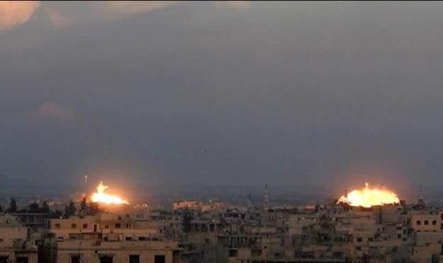 Pháo binh quân đội Syria bắn phá chiến tuyến phiến quân ở Đông Ghouta - ảnh minh họa Masdar News