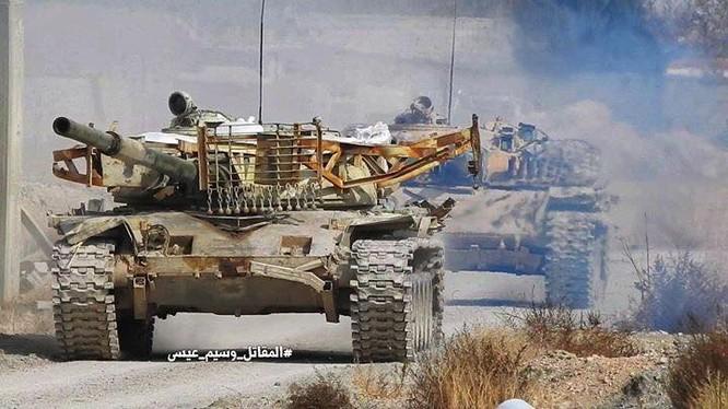 Tăng, thiết giáp quân đội Syria trên chiến trường Đông Ghouta - ảnh minh họa Masdar News