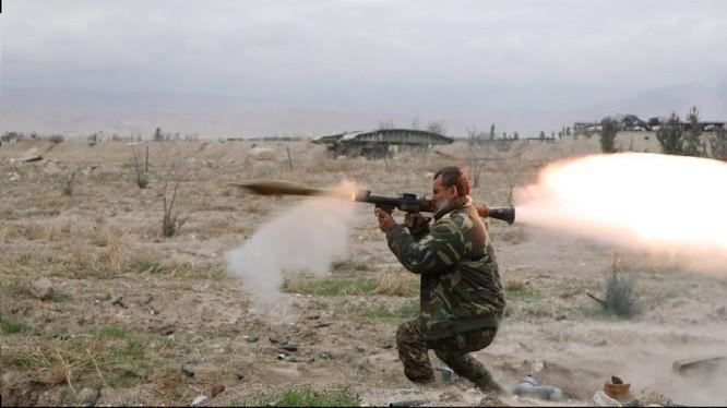 Binh sĩ quân đội Syria chiến đấu trên chiến trường Đông Ghouta - ảnh minh họa Masdar News