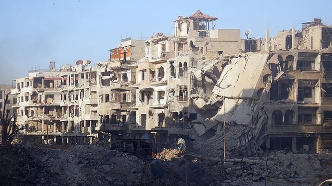 Khu phố quận Ayma, Ramalka, Erbeen tan hoang sau cuộc chiến tranh - ảnh minh họa Mssdar News